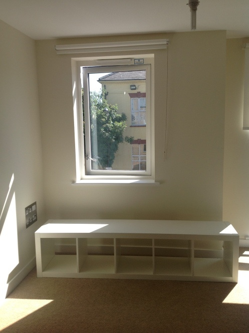 using Ikea Expedit shelf as window bench